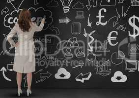Businesswoman looking at business plan concept on blackboard