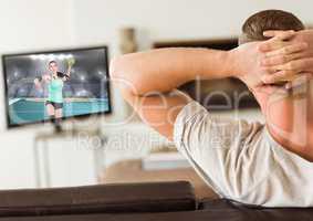 Man watching handball on television at home