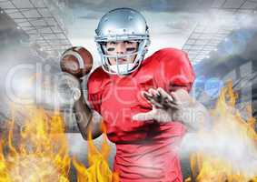 Portrait of athlete playing american football between the fire flame
