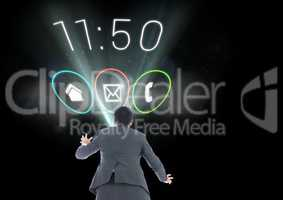 Digital composite image of a businessman with applications icons