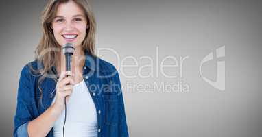 Portrait of beautiful woman singing a song on microphone