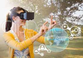 Woman touching interface screen while using virtual reality headset