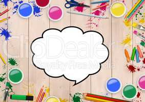 Drawn speech bubble with color pencils and paint on wooden background