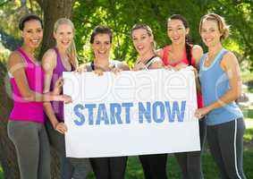 Group of happy women holding placard with text start now