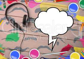 Drawn speech bubble and headphones with color pencils on wooden background