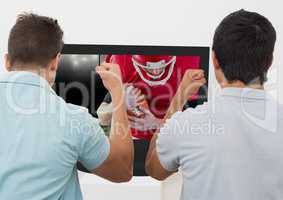 Friends cheering while watching american football match on television