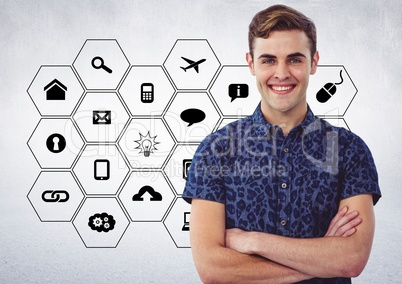 Male executive standing with arms crossed against application icons