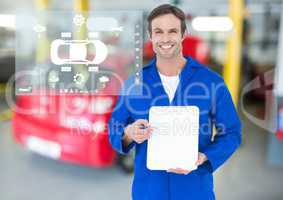 Portrait of smiling mechanic showing clipboard in garage