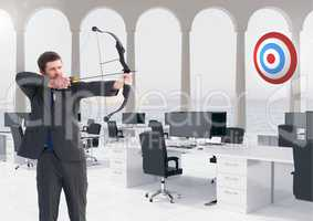 Businessman aiming at the target board against office in background