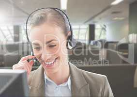 Customer service woman talking on headphone in office