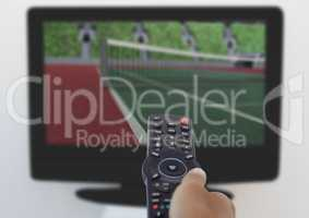 Hand changing channel from remote control