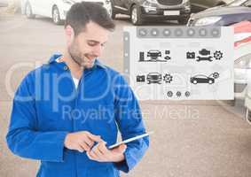 Mechanic using digital tablet with car mechanic interface in background