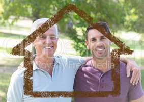 Dad and son standing together in the park with house outline