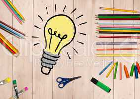 Innovative bulb surrounded by stationery on wooden background