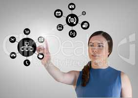 Woman touching applications interface against grey background