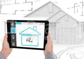 Digital composite image of hand holding a digital tablet with house security concept
