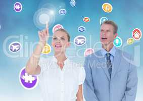 Business executives touching digitally generated application icons