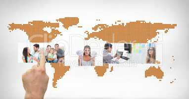 Hands touching digital pictures interface against world map