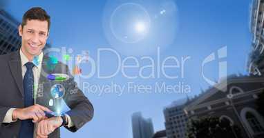 Portrait of smiling businessman using smart watch