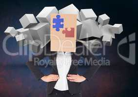Businesswoman covered with cardboard box showing jigsaw puzzles and white cubes in backgrounds