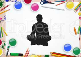 Silhouette of man sitting against stationary items in background
