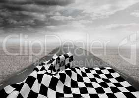 Checkered flag on road against stormy sky