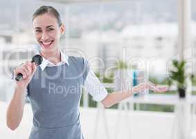 Businesswoman public speaking on microphone in office