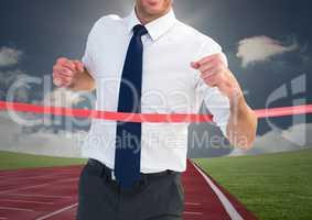 Digital composite image of a businessman winning the race