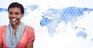 Smiling woman standing against world map with hexagonal pattern