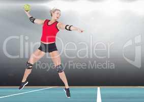 Player playing handball in stadium