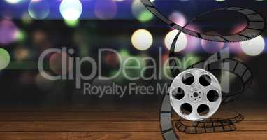 Film reel against bokeh background