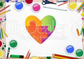 Heart shape on white card against stationary items in background