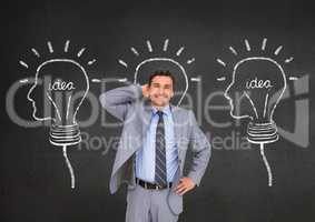 Smiling businessman standing with hand on hip against innovative idea bulb