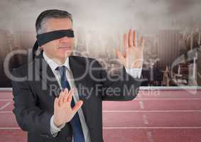 Digital composite image of blind folded businessman
