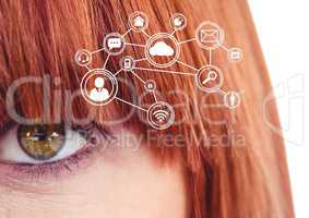 Eye of woman looking at cloud computing digital interface