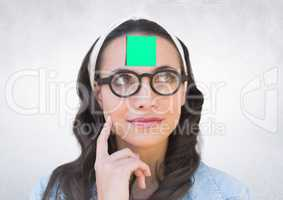 Thoughful woman with sticky note stuck on her forehead against white background