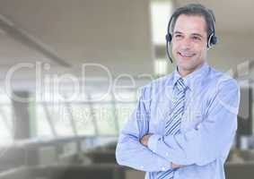 Customer service executive standing with arms crossed at office