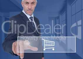 Businessman touching shopping cart icon on interface screen
