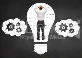Businessman trapped in electric bulb against black background