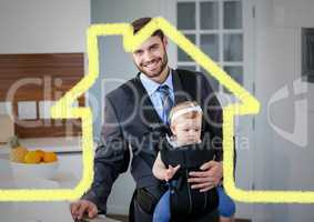Dad carrying his baby in baby carrier against house outline in background