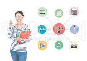 Woman holding stack of books with various applications