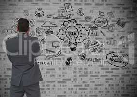 Confused man looking at social networking icons on wall background
