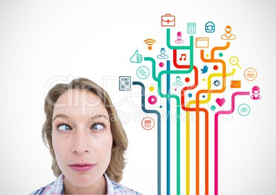 Squint eyed woman standing against application icons