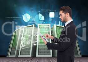 Businessman using digital tablet against server room and graph chart background