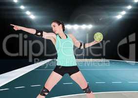 Female handball player throwing ball at handball court