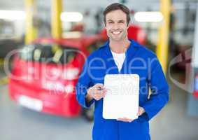 Mechanic holding clipboard in repair garage