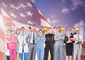 Group of businesspeople standing together against american flag and cloudy sky in background