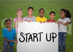 Portrait of kids standing with placard with start up text