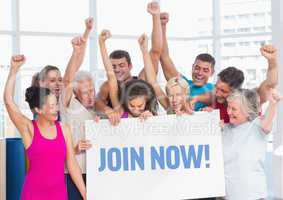 Group of cheerful people holding placard with text join now