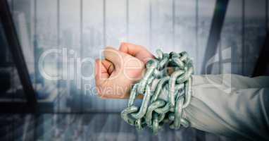 Businessman hands bound in chains